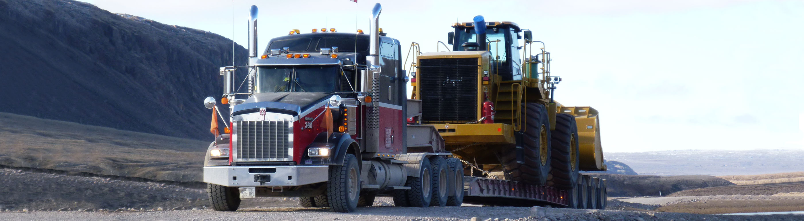 Heavy haul truck transporting construction equipment